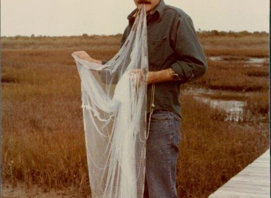 Roger Allen with fishing net, 1980s